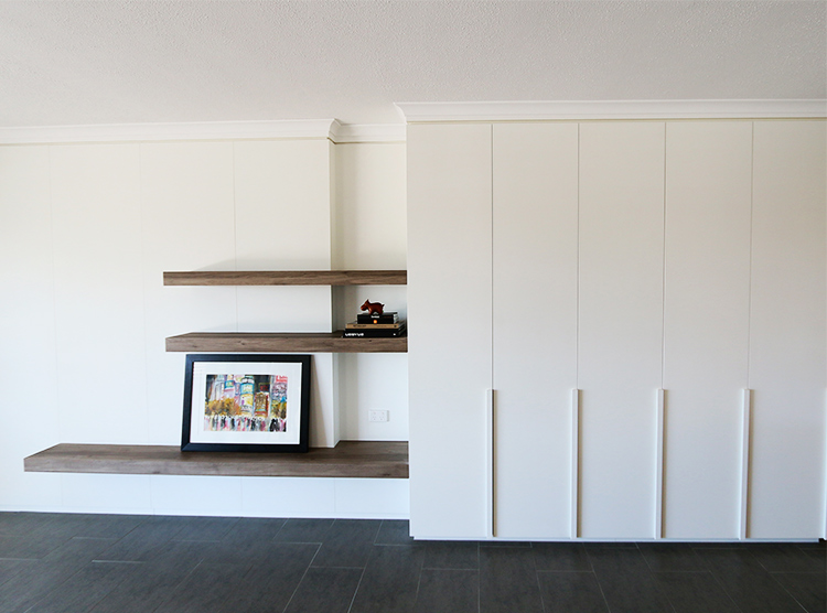 apartment makeover Brisbane, living room storage, timber shelves